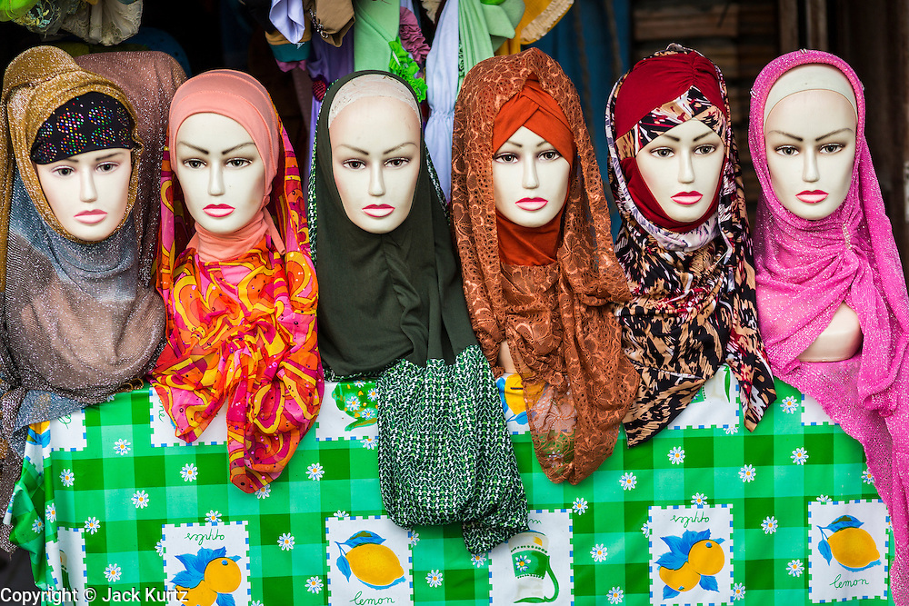 09 JULY 2013 - PATTANI, PATTANI, THAILAND: Muslim headscarves (hijab) for sale in the market in Pattani.  Pattani, along with Narathiwat and Yala, are the only three Muslim majority provinces in Thailand.     PHOTO BY JACK KURTZ