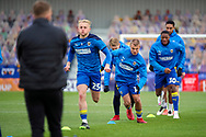 AFC Wimbledon midfielder Jaakko Oksanen (16) warming up prior to kick off during the EFL Sky Bet League 1 match between AFC Wimbledon and Lincoln City at Plough Lane, London, United Kingdom on 2 January 2021.