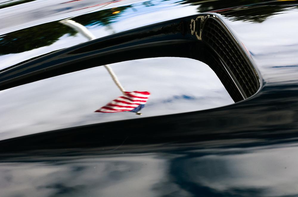 American flag reflection on an automobile hood, morning light, August, Clallam County Fair, Port Angeles, Wasington, USA