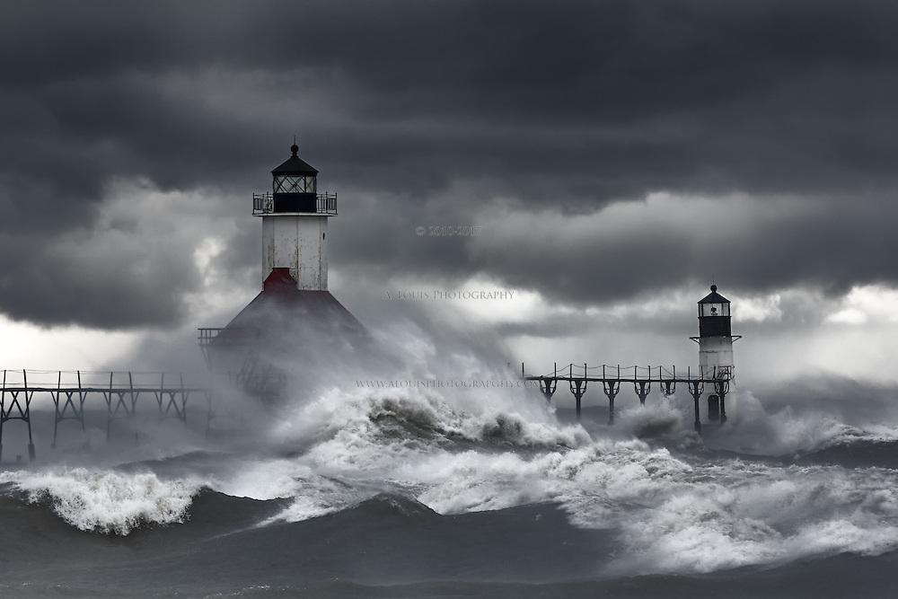 Relentless waves spawned from gale force winds pummel the lighthouses on Lake Michigan in St. Joseph on this day in Late October