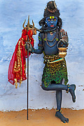 A young boy is dressed as the Hindu god Shiva,to raise funds during the November Pushkar Fair