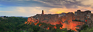 Pitigliano is a medieval town in the Maremma area of Tuscany. The town stands on an abrupt tuff butte high above the Olpeta, the Fiora and the Lente rivers. Taken a few minutes after sunset on an evening at the end of April, this is stitched from eleven vertical frames