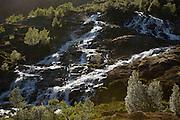 Backlit waterfall near Sørvågen in the Lofoten Islands, Norway