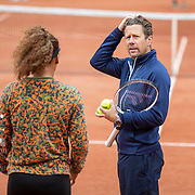 PARIS, FRANCE May 26. Naomi Osaka of Japan with coach Wim Fissette during practice on Court Philippe-Chatrier in preparation for the 2021 French Open Tennis Tournament at Roland Garros on May 2pm 6th 2021 in Paris, France. (Photo by Tim Clayton/Corbis via Getty Images)