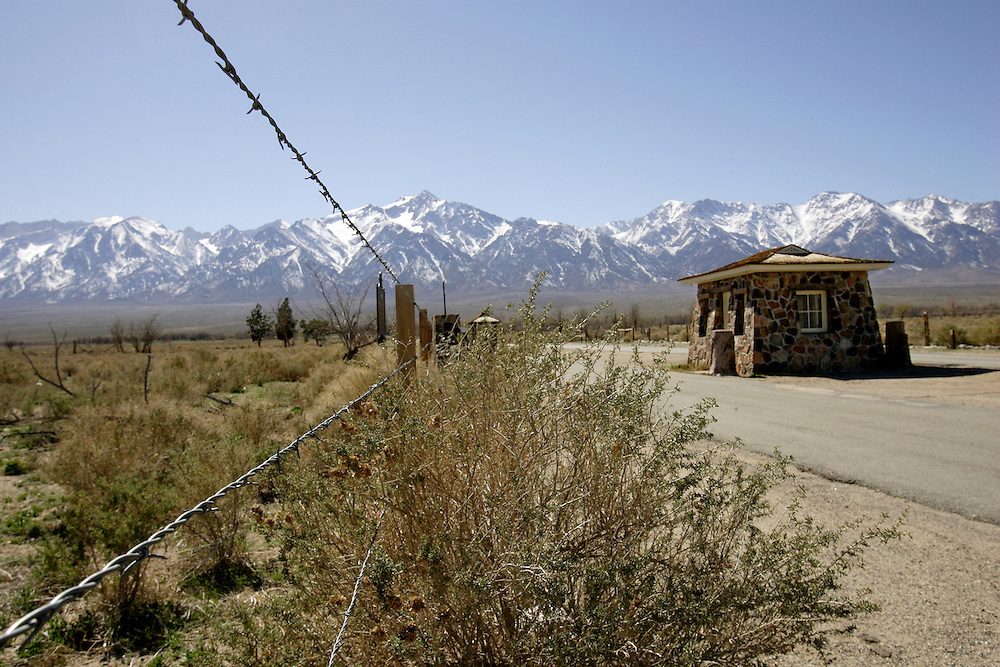 INDEPENDENCE, CA, March 19, 2008: The sentry posts Manzanar, one of ten remote War Relocation Centers in the United States where 11,000 Japanese were sent beginning in early 1942 during World War II, were built by a internee at the camp. Not trusting those with cultural ties to Japan who had bombed Pearl Harbor, the U.S. Government enclosed a  one square mile, remote area in the Eastern Sierra mountains with barbed wire and erected a mini city complete with churches, barracks, mess halls, hospitals and even baseball fields. A cemetery and graves still adorn the property which is now a National Historic Site.