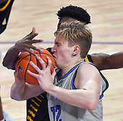St Louis Billikens forward Marten Linssen (12) gets smacked in the face with the ball as he is defended by Arkansas-Pine Bluff Golden Lions forward Alvin Stredic Jr. (15). St. Louis University hosted the University of Arkansas - Pine Bluff in a mens basketball game on December 5, 2020 at Chaifetz Arena on the SLU campus in St. Louis, MO.<br /> Photo by Tim Vizer