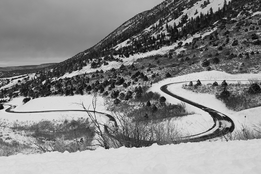 Colorless snow covered bend on La Sal Mountain Loop Road ...