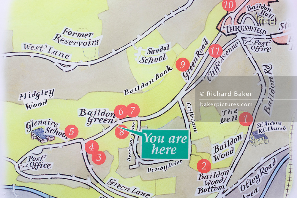 An arrow pointing to the You Are Here location on a map  of Baildon Green near Shipley and Bradford, showing the streets, roads and landmarks of this Yorkshire village.