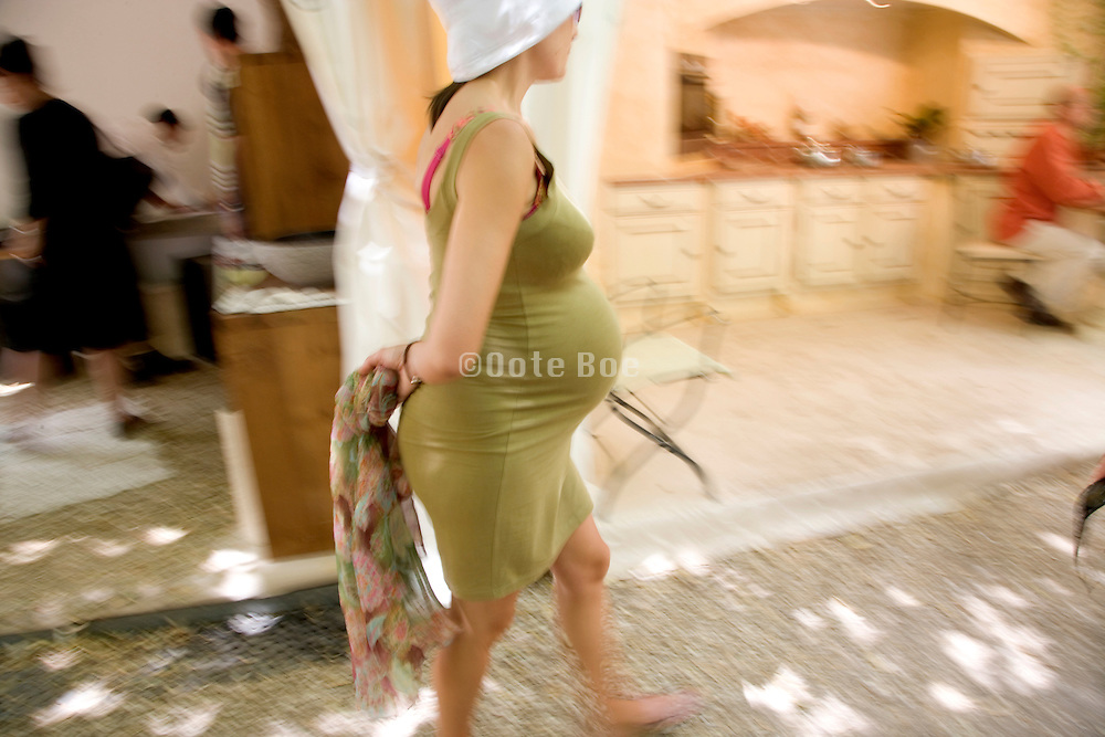 pregnant woman walking in highly stretchable clothing