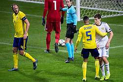 November 20, 2018 - Stockholm, SWEDEN - 181120 Daler Kuzyaev of Russia in a discussion with Martin Olsson of Sweden during the Nations League football match between Sweden and Russia on November 20, 2018 in Stockholm  (Credit Image: © Simon HastegRd/Bildbyran via ZUMA Press)