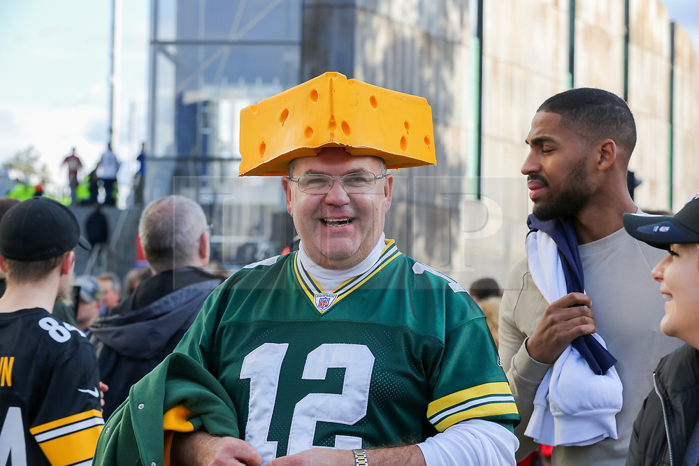 © Licensed to London News Pictures. 06/10/2019. London, UK. An American Football fan with a cheese hat arrives for the NFL (The National Football League) London Games when Oakland Raiders faces Chicago Bears in the first of the two games to be played at the new Tottenham Hotspur Stadium. Photo credit: Dinendra Haria/LNP