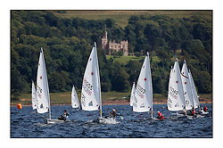 Perfect conditions at day 4 of the World Laser Radial Youth Championships, Largs, Scotland...Girls yellow fleet downwind with Stavroula Theoxari GRE 189255 and Marie Benoit FRA 180303..317 Youth Sailors from 42 different nations compete in the World and European Laser Radial Youth Champiponship from the 17-25 July 2010...The Laser Radial World Championships take place every year. This is the first time they have been held in Scotland and are part of the initiaitve to bring key world class events to Britain in the lead up to the 2012 Olympic Games. ..The Laser is the world's most popular singlehanded sailing dinghy and is sailed and raced worldwide. ..Further media information from .laserworlds@gmail.com.event press officer mobile +44 7866 571932 and +44 1475 675129 .
