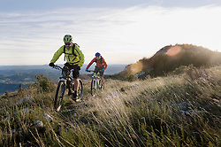 two mountain bikers on the way downhill, Vipava valley, Istria, Slovenia