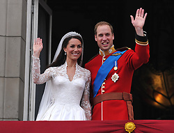 Prince William and his wife Kate Middleton, who has been given the title of The Duchess of Cambridge, wave to the crowd from the balcony of Buckingham Palace, London, following their wedding at Westminster Abbey.