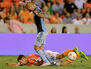 Oct 9, 2013; Houston, TX, USA; Houston Dynamo forward Will Bruin (12) lands hard after drawing a foul against the Sporting KC during the first half at BBVA Compass Stadium. Mandatory Credit: Thomas Campbell-USA TODAY Sports