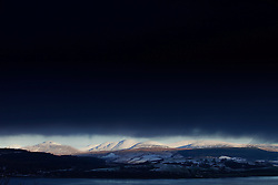 Mountain landscape stormy snow dark sky winter