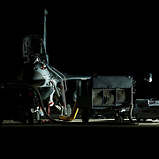 A U.S. Air Force F-16 Fighting Falcon sits under lights as maintenance is performed, Feb 24, 2015, in an undisclosed location in southwest Asia(U.S. Air Force photo by Staff Sgt. Perry Aston/Released)