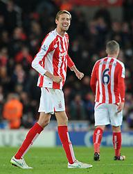 Stoke's Peter Crouch celebrates on the final whistle  - Photo mandatory by-line: Dougie Allward/JMP - Mobile: 07966 386802 - 06/12/2014 - SPORT - Football - Stoke - Britannia Stadium - Stoke City v Arsenal - Barclays Premie League