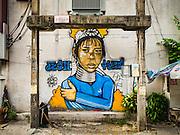09 SEPTEMBER 2016 - BANGKOK, THAILAND:  A mural on the side of a building on Ekkamai Soi 4.      PHOTO BY JACK KURTZ