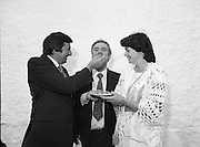 """The Carlingford Oyster Festival.1982.19.08.1982..08.19.1982.19th August 1982..Pictures and Images of the Carlingford Oyster Festival... The Minister For Fisheries and Forestry Mr Brendan Daly officially opened  The Carlingford Oyster Festival. The Chairman of the organising committee was Mr. Joe McKevitt..""""The Oyster Pearl"""" was Ms Deirdre McGrath..The Minister offers the chairman Mr McKevitt an oyster."""