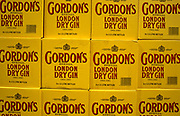With royal crests, twelve boxes of Gordon's special Dry Gin are stacked at a duty free logistics warehouse near Heathrow airport,  destined for departing passengers. There are six one and a half litre bottles inside these yellow boxes marked with the famous Gordon's brand, produced in the United Kingdom and under license in other former British territories, owned by the alcohol company Diageo Plc. It was developed in London in 1769 by a Scot, Alexander Gordon. The Special London Dry Gin he developed proved successful, and its recipe remains unchanged to this day. Triple-distilled, the gin contains juniper berries, coriander seeds, angelica root and one other botanical ingredients though the recipe for Gordon's is known to only four people in the world and has been kept a secret for 200 years.nt transporting of goods in and out of this logistics hub.
