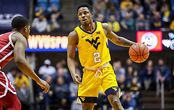 Feb 2, 2019; Morgantown, WV, USA; West Virginia Mountaineers guard Brandon Knapper (2) dribbles during the second half against the Oklahoma Sooners at WVU Coliseum. Mandatory Credit: Ben Queen-USA TODAY Sports