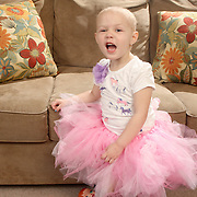 Holly Larue Frizzelle, 2 poses for a portrait in a tutu that was donated to her by her pharmacist.