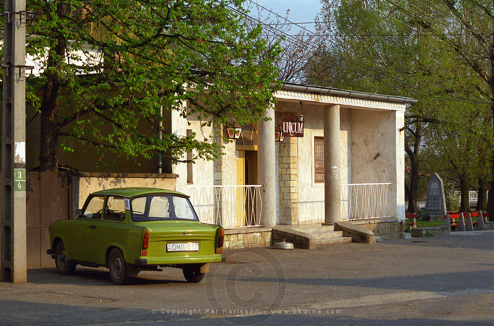 """In the Tokaj village Mad: a bar / café with a sign advertising """"Unicum"""" the very typical Hungarian alcohol and a classic Trabant car. Mad is one of the main villages in the Tokaj district.  Credit Per Karlsson BKWine.com"""