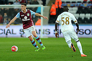 Aston Villa's Ciaran Clark (l) in action. Barclays Premier league match, Swansea city v Aston Villa at the Liberty Stadium in Swansea, South Wales on Saturday 19th March 2016.<br /> pic by  Carl Robertson, Andrew Orchard sports photography.