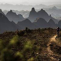 Aaron Gulley and Daine Zaffke riding to camp, Ethiopia.