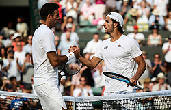 LONDON, July 6, 2018  Juan Martin Del Potro (L) of Argentina shakes hands with Feliciano Lopez of Spain after their men's singles second round match at the Wimbledon Championships 2018 in London, Britain, on July 5, 2018. Juan Martin Del Potro won 3-0. (Credit Image: © Tang Shi/Xinhua via ZUMA Wire)