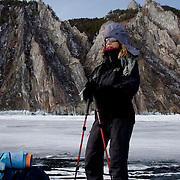 Heleen treks near the Olkhon Island after crossing the frozen Lake Baikal in Siberia, Russia. (third day)..They are a group of five people: Justin Jin (Chinese-British), Heleen van Geest (Dutch), Nastya and Misha Martynov (Russian) and their Russian guide Arkady. .They pulled their sledges 80 km across the world's deepest lake, taking a break on Olkhon Island. They slept two nights on the ice in -15c. .Baikal, the world's largest lake by volume, contains one-fifth of the earth's fresh water and plunges to a depth of 1,637 metres..The lake is frozen from November to April, allowing people to cross by cars and lorries.