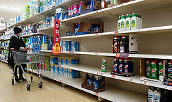© Licensed to London News Pictures. 15/10/2021. London, UK. A shopper looks at nearly empty shelves of detergent products in Sainsbury's, north London, amid fears of shortage of essential items. The Government and retailers warn that food shortages could continue until Christmas due to labour shortages, following Brexit. Study research, conducted by delivery management experts Urbantz, reports that one in six Londoners reported that when they went food shopping, items they needed were not available and they could not find a replacement, while half of respondents said there was less variety of food in the shops than usual. Another 1-in-6 London residents were also unable to purchase fuel in the last fortnight. Photo credit: Dinendra Haria/LNP