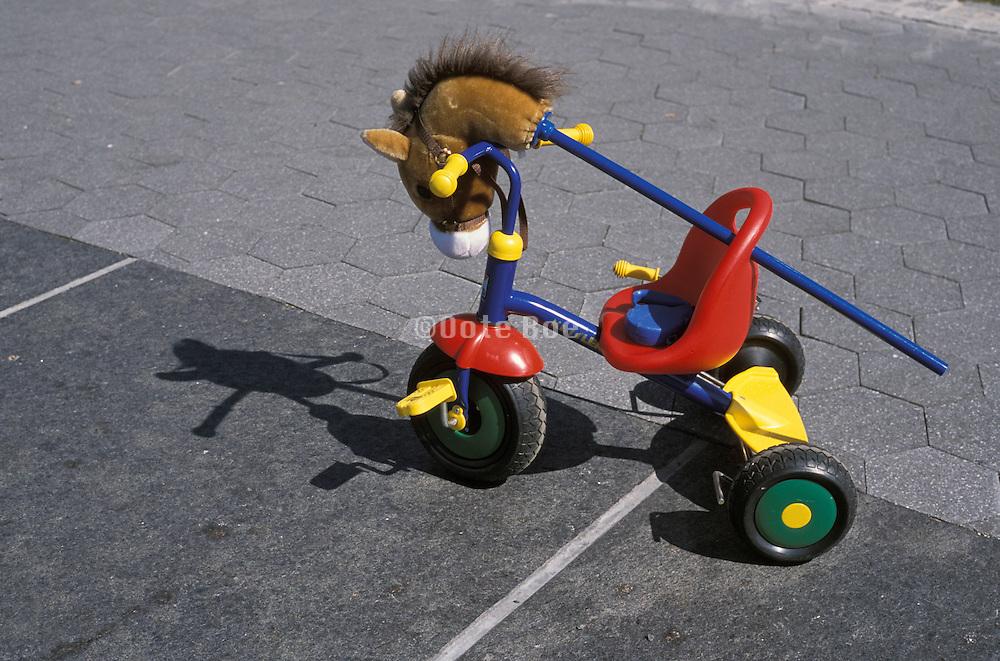 Child?s toy on the sidewalk