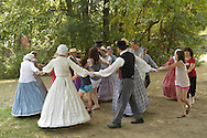 Old Bethpage, New York, U.S. 31st August 2013.  The Old Bethpage Village Dancers and children and adult visitors are dancing during the Olde Time Music Weekend at Old Bethpage Village Restoration, where popular music of the American Civil War period was performed, and visitors learn traditional 1800's contradances.