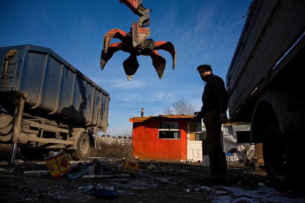Roma living in the Belville camp in New Belgrade. Truck takes away scrap metal for processing.