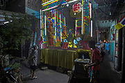 A narrow lane community in the Yaowarat district of Chinatown, centred around the Jade Hubol restaurant, sponsors a Xiqu performance.  I Lai Heng Giah Tuang Chinese Opera troupe perform on the smallest stage known in Bangkok for Xiqu.