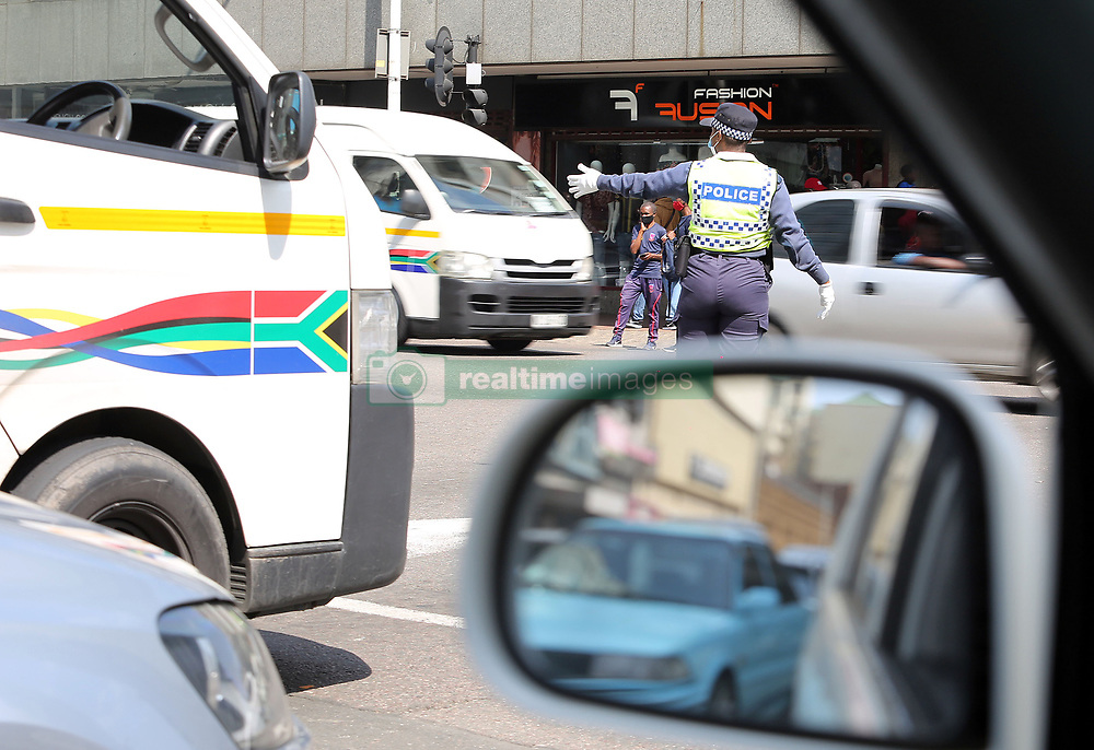 SOUTH AFRICA - Durban - 03 September 2020 - A Metro Police officer control the traffic at Dr AB Xuma street and Soldiers Way road causing the frustration on the roads and  delays when traffic lights are out due to stage 4 loadshedding in the Durban CBD.<br /> Picture: Motshwari Mofokeng/African News Agency (ANA)