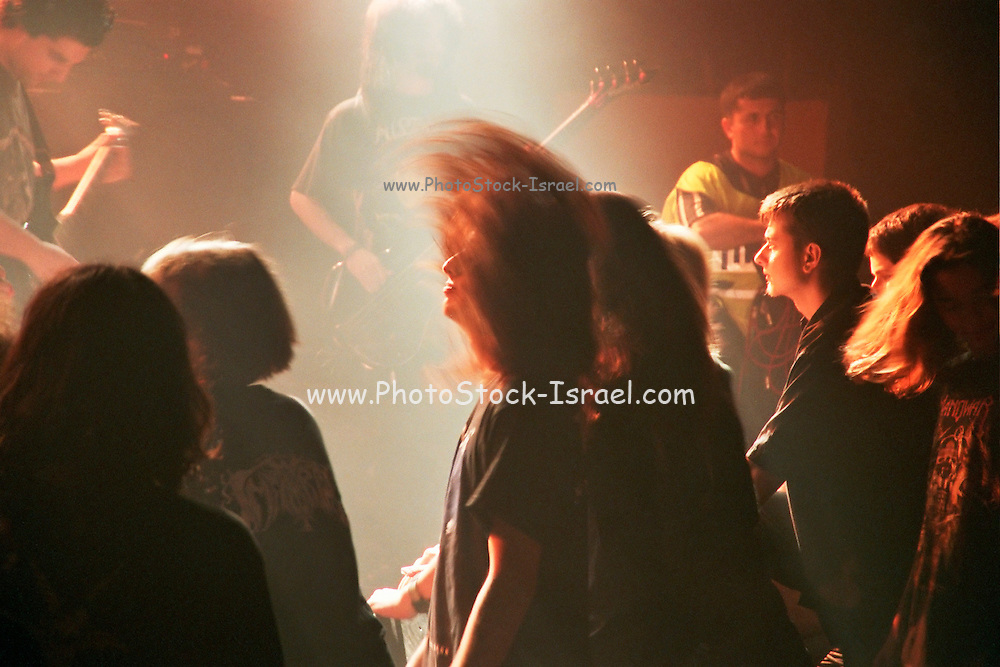 Israel, Tel Aviv, Bartholomeus band during a Heavy Metal rock performance the ecstatic crowd in the foreground