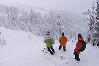 Three young men riding at Kirkwood ski resort near Lake Tahoe, CA.