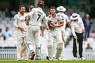 Ollie Robinson of Kent commiserates with Ben Foakes of Surrey after the Specsavers County Champ Div 1 match between Surrey County Cricket Club and Kent County Cricket Club at the Kia Oval, Kennington, United Kingdom on 10 July 2019.