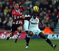 Photo: Javier Garcia/Back Page Images<br />Southampton v Middlesboro, FA Barclays Premiership, St Mary's Stadium 11/12/04<br />Kevin Phillips, left, battles with George Boateng