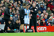 Chris Lowe of Huddersfield Town returns to the pitch after receiving medical attention. Premier League match, Liverpool v Huddersfield Town at the Anfield stadium in Liverpool, Merseyside on Saturday 28th October 2017.<br /> pic by Chris Stading, Andrew Orchard sports photography.