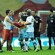 Galatasaray's Arda TURAN (2ndL) and Trabzonspor's Ibrahima YATTARA (C) during their Turkish superleague soccer derby match Galatasaray between Trabzonspor at the TT Arena in Istanbul Turkey on Sunday, 10 April 2011. Photo by TURKPIX
