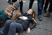 Glued on protesters during Extinction Rebellion disruption outside City Airport on 10th October 2019 in London, England, United Kingdom. The protest is against the climate and pollution impact of the government's plans for airport expansion which will potentially double the amount of flights coming from City Airport. Extinction Rebellion is a climate change group started in 2018 and has gained a huge following of people committed to peaceful protests. These protests are highlighting that the government is not doing enough to avoid catastrophic climate change and to demand the government take radical action to save the planet.