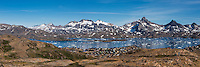 Mountain view over village of Tasiilaq on shore of Kong Oscars Havn, Greenland