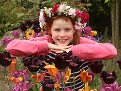 © Licensed to London News Pictures. 12/05/2018. Shepton Mallet, UK. Somerset Garden Day, Alice Woodyatt aged 10 with the Flower crown that she made at, Kilver Court, Shepton Mallet, Somerset, Photo credit: Jason Bryant/LNP