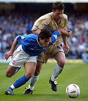 Photographer: Scott Heavey<br />Ipswich Town V Portsmouth. 18/04/03.<br /> Pablo Counago beats Arjan De-Zeeuw during this Nationwide Division one match at Portland Road.