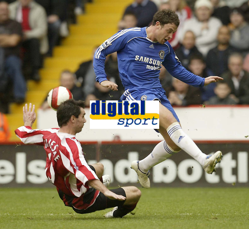 Photo: Aidan Ellis.<br /> Sheffield United v Chelsea. The Barclays Premiership. 28/10/2006.<br /> Chelsea's Wayne Bridge clears from Sheffield's Keith Gillespie