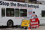 A pro-Brexiter protestor and a Leave Means Leave bus at the junction of Parliament Square in a week that Prime Minister Theresa May asks for MPs to back her Brexit deal, on 14th January 2019, in Westminster, London, England.